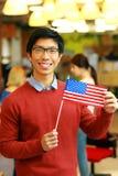 Ασιατική σημαία εκμετάλλευσης σπουδαστών των ΗΠΑ Στοκ Εικόνες