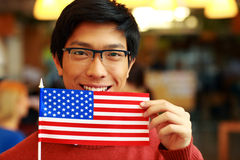 Ασιατική σημαία εκμετάλλευσης σπουδαστών των ΗΠΑ Στοκ εικόνα με δικαίωμα ελεύθερης χρήσης