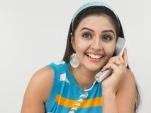 ασιατική τηλεφωνική μιλών&t Στοκ φωτογραφία με δικαίωμα ελεύθερης χρήσης