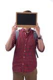Ασιατικός άνδρας σπουδαστής που καλύπτει το πρόσωπό του με έναν πίνακα κιμωλίας Στοκ Εικόνα