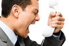 Ασιατικός επιχειρηματίας που φωνάζει στο τηλέφωνο Στοκ φωτογραφία με δικαίωμα ελεύθερης χρήσης
