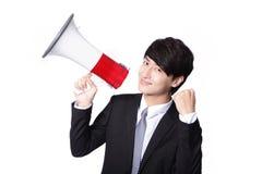 Ασιατικός επιχειρηματίας που χρησιμοποιεί bullhorn Στοκ Εικόνες