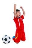 Ασιατικός ποδοσφαιριστής που παρουσιάζει βραχίονα επάνω στη χειρονομία Δράση του νικητή ή Στοκ Φωτογραφίες