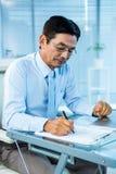 Ασιατικό γράψιμο επιχειρηματιών Στοκ Φωτογραφία