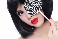Ασιατικό κορίτσι με το lollipop Στοκ Εικόνα