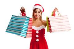 Ασιατικό κορίτσι Χριστουγέννων με τα ενδύματα Santa και την τσάντα αγορών Στοκ φωτογραφία με δικαίωμα ελεύθερης χρήσης