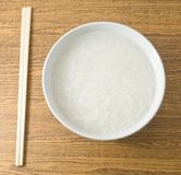 Ασιατικό κουάκερ ρυζιού ή μαλακό βρασμένο ρύζι Στοκ Φωτογραφίες
