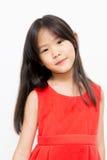 Ασιατικό παιδί με το κόκκινο φόρεμα Στοκ φωτογραφία με δικαίωμα ελεύθερης χρήσης