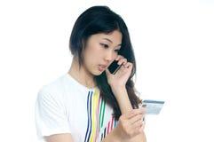 ασιατικό πιστωτικό κορίτσι καρτών Στοκ Εικόνες
