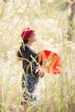 Ασιατικό πορτρέτο γυναικών με την κόκκινη ομπρέλα Στοκ Εικόνες