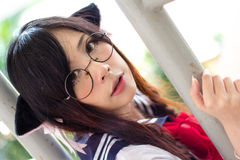 Ασιατικό σχολικό κορίτσι με τα γοητευτικά μάτια Στοκ Φωτογραφία