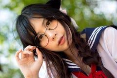 Ασιατικό σχολικό κορίτσι με τα γοητευτικά μάτια Στοκ Εικόνα