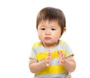 Ασιατικό χέρι χειροκροτήματος μωρών Στοκ Εικόνες