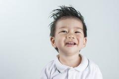 Ασιατικό χαμόγελο αγοριών πορτρέτου με το διάστημα για το κείμενο Στοκ εικόνα με δικαίωμα ελεύθερης χρήσης