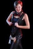 Αστέρας της ροκ που κρατά την ηλεκτρική κιθάρα της κορίτσι προκλητικό Στοκ Φωτογραφία