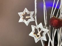 Αστέρια Χριστουγέννων και μήλο καραμέλας στοκ φωτογραφία