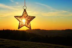 Αστέρι Χριστουγέννων και φωτεινός ήλιος Στοκ εικόνες με δικαίωμα ελεύθερης χρήσης