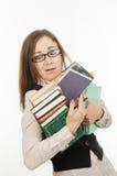 Αστείος δάσκαλος με τα βιβλία και τα σημειωματάρια Στοκ Εικόνες