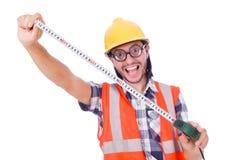 Αστείος εργαζόμενος constructon με την ταινία-γραμμή που απομονώνεται Στοκ Εικόνες
