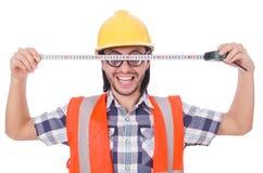 Αστείος εργαζόμενος constructon με την ταινία-γραμμή που απομονώνεται Στοκ Φωτογραφίες
