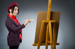Αστείος καλλιτέχνης με το έργο τέχνης του Στοκ εικόνα με δικαίωμα ελεύθερης χρήσης