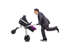 Αστείος μπαμπάς με το μωρό και καροτσάκι στο λευκό Στοκ Εικόνες