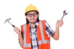 Αστείος νέος εργάτης οικοδομών με το σφυρί και Στοκ φωτογραφία με δικαίωμα ελεύθερης χρήσης