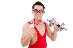 Αστείος τύπος με τα dumbbels Στοκ Φωτογραφία