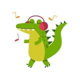 Αστείος χαρακτήρας κροκοδείλων κινούμενων σχεδίων στη μουσική ακούσματος ακουστικών και τη διανυσματική απεικόνιση περπατήματος Στοκ Φωτογραφία