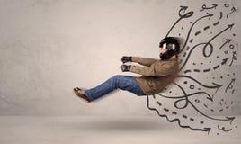 Αστείο άτομο που οδηγεί ένα πετώντας όχημα με συρμένες τις χέρι γραμμές μετά από το χ Στοκ φωτογραφία με δικαίωμα ελεύθερης χρήσης