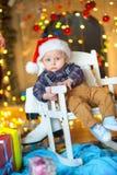 Αστείο παιδί σε ένα εορταστικό υπόβαθρο Στοκ Εικόνα