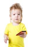 Αστείο παιδί που μιλά σε ένα τηλέφωνο κυττάρων που απομονώνεται Στοκ εικόνες με δικαίωμα ελεύθερης χρήσης
