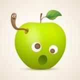 Αστείο πράσινο μήλο με το σκουλήκι Στοκ φωτογραφία με δικαίωμα ελεύθερης χρήσης