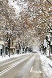 Αστική οδός σε μια θύελλα χιονιού Στοκ Εικόνες
