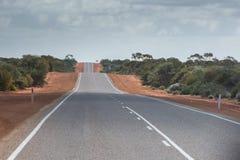 Ατελείωτος δρόμος ερήμων της δυτικής Αυστραλίας Στοκ Εικόνες