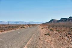 Ατελείωτος δρόμος στην έρημο Σαχάρας Στοκ φωτογραφία με δικαίωμα ελεύθερης χρήσης
