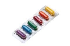 Αυγά εξαρτήσεων χρωστικών ουσιών φουσκαλών δόσεων μονάδων για Πάσχα, που απομονώνεται με την πορεία Στοκ εικόνα με δικαίωμα ελεύθερης χρήσης