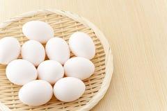 αυγά καλαθιών επίπεδα πολλά Στοκ Εικόνα