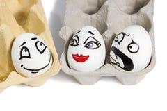 Αυγά με τα χρωματισμένα πρόσωπα Στοκ Εικόνα