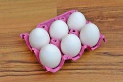 Αυγά στο κιβώτιο που απομονώνεται Στοκ Εικόνα