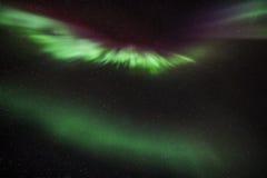 Αυγή Borealis πέρα από το Ρέικιαβικ Στοκ Εικόνα