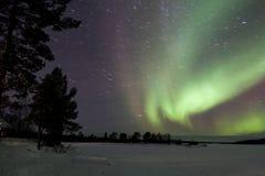 Αυγή Borealis σε Inari, Lapland, Φινλανδία Στοκ Εικόνα