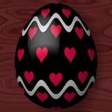 Αυγό Πάσχας με τις καρδιές και τις κυματιστές γραμμές Στοκ εικόνες με δικαίωμα ελεύθερης χρήσης