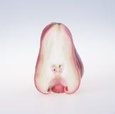 Αυξήθηκε Apple αυξήθηκε μήλο στο υπόβαθρο Στοκ φωτογραφία με δικαίωμα ελεύθερης χρήσης