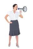 Αυστηρή επιχειρηματίας που φωνάζει megaphone της Στοκ Εικόνες
