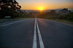 Αυστραλιανός δρόμος στο ηλιοβασίλεμα Στοκ Φωτογραφία