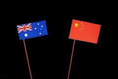 Αυστραλιανή σημαία με την κινεζική σημαία στο Μαύρο Στοκ εικόνα με δικαίωμα ελεύθερης χρήσης