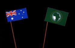 Αυστραλιανή σημαία την αφρικανική σημαία ένωσης που απομονώνεται με στο Μαύρο Στοκ Εικόνα