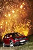 Αυτοκίνητο κάτω από τα πυροτεχνήματα Στοκ Φωτογραφίες