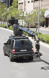 Αυτοκίνητο καμερών υψηλής ταχύτητας με τη κάμερα κινηματογράφων Στοκ εικόνα με δικαίωμα ελεύθερης χρήσης